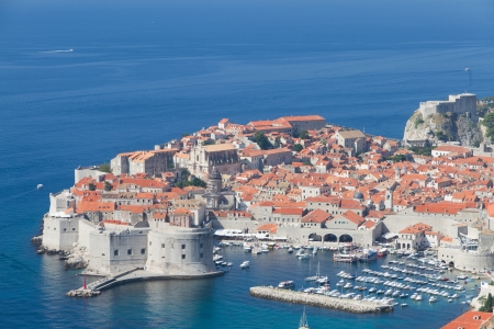 peninsula of walled Dubrovnik old town with harbor, Croatia photo
