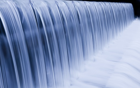 water cascade streaming down a lasher, cool white balance, concept for water saving, conservation, keeping water clean Stock Photo