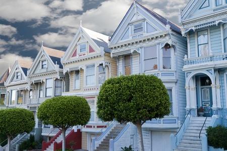 cartoline vittoriane: painted ladies case vittoriane colorati vicino Alamo Square, San Francisco, in California Archivio Fotografico