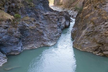 blue mountain river stream cutting through the rock, at Viamala near Thusis Switzerland