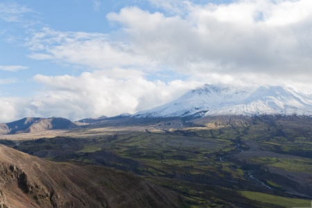 trenches: volcano mount Saint Helens decapitated top with glacier and surrounding bogland with trenches and  in clouds