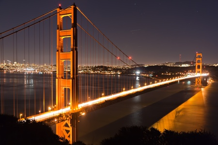 Golden Gate bridge San Francisco at dusk reflecting in the surrounding bay photo