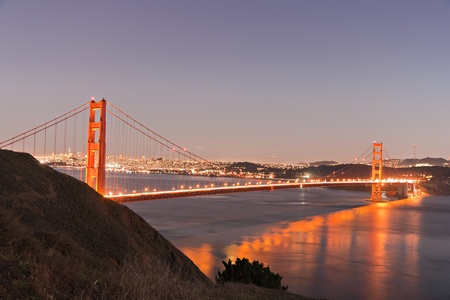 Golden Gate bridge San Francisco at dusk reflecting in the surrounding bay Stock Photo - 9618572