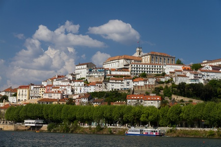 Old town of Coimbra under a summer sky at the river bank, Portugal Stock Photo - 9701707