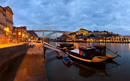 panorama old Porto river Duoro, vintage port transporting boats, old town, town of Gaia and famous bridge Ponte dom Luis, Portugal photo