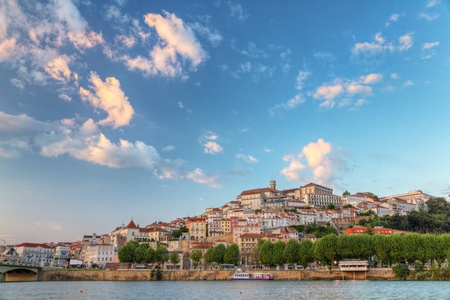 Old town of coimbra glows at sunset under a pretty summer sky, Portugal Stock Photo