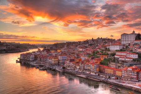 oporto: Panorama old city Porto at river Duoro,with Port transporting boats at sunset,  Oporto, Portugal