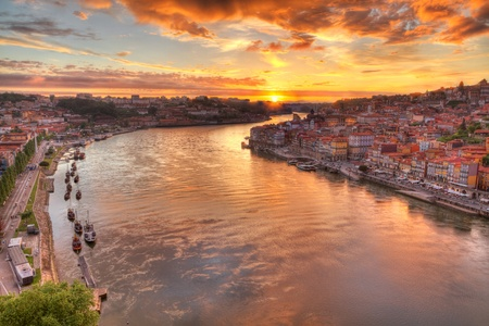 Panorama old city Porto at river Duoro,with Port transporting boats at sunset,  Oporto, Portugal photo