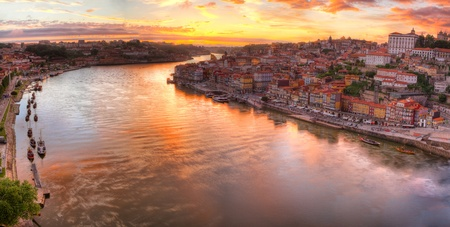 Panorama old city Porto at river Duoro,with Port transporting boats at sunset,  Oporto, Portugal