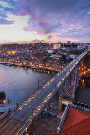 oporto: Lighted  famous bridge Ponte dom Luis above  Old town Porto at river Duoro at night, Portugal