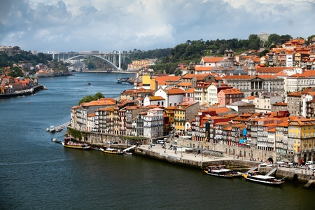 porto: Panorama old city Porto at river Duoro,with Port transporting boats on a summer day, Oporto, Portugal  Stock Photo