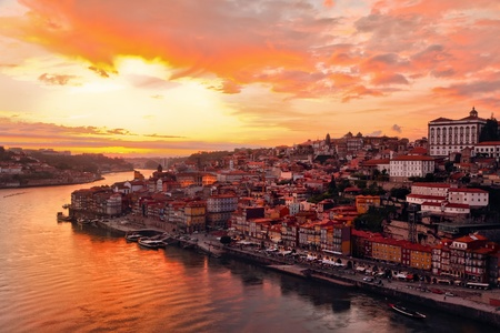transporting: Panorama old city Porto at river Duoro,with Port transporting boats at sunset,  Oporto, Portugal