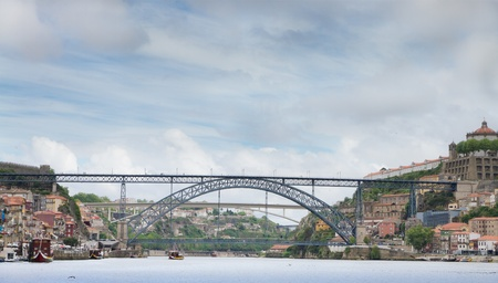 Famous steel bridge Ponte dom Luis above  connetcs Old town Porto with Vila Nova de Gaia at river Duoro, Portugal   Stock Photo - 10738458