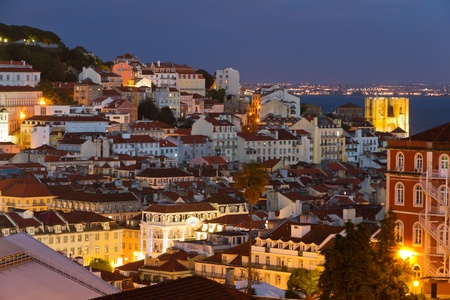 europe vintage: historic mediterranean architecture with church at night with light in Lisboa, Portugal