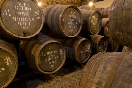 portuguese: wooden barrels hold Port fortified wine to mature in wine cellars in Villa Nova de Gaia, Portugal Editorial
