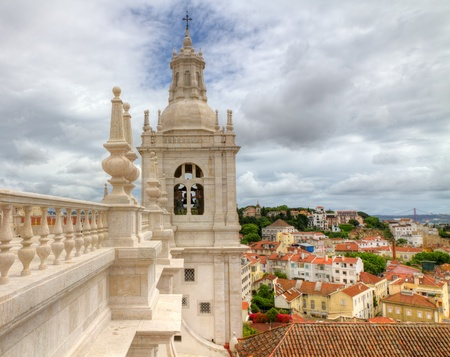 lisboa: White roof  with decorations and bell tower in mannerist style of famous church and cloister Sao Vicente de Fora Lisbon above the city , Portugal.