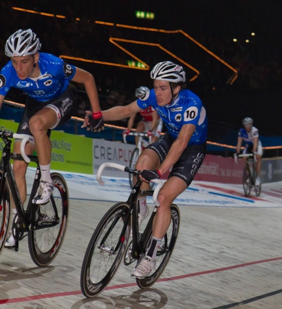 ZURICH-NOV. 30: Professional Team Hester Morkov changes lead role at Americaine race at Sixday-Nights Z�rich 2011 at Zurich Hallenstadion November 30, 2011 in Zurich SUI.