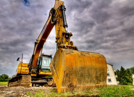 menacing: digger showing menacing strength, power, size, weight of this road construction vehicle