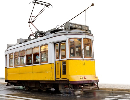 historic classic yellow tram of Lisbon built partially isolated on white, Portugal Stock Photo - 12200881