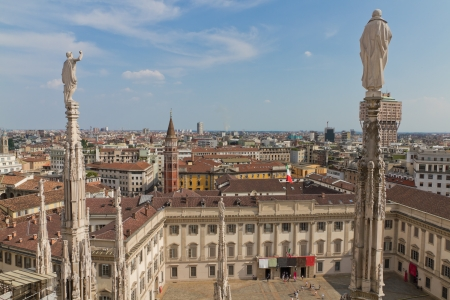 Aerial view from cathedral of Milan and its intricate decorations over Milan, Italy