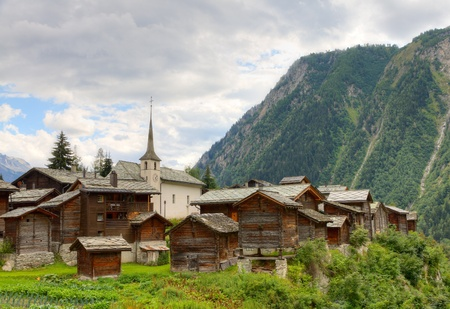 valais: small swiss village settlement Blatten Naters of withered wooden houses and church  in canton Valais  Switzerland