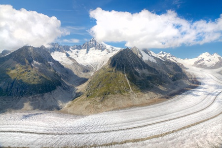 concept for hiking, climbing, walking and outdoor adventures   panorama view above long Aletsch glacier Switzerland photo