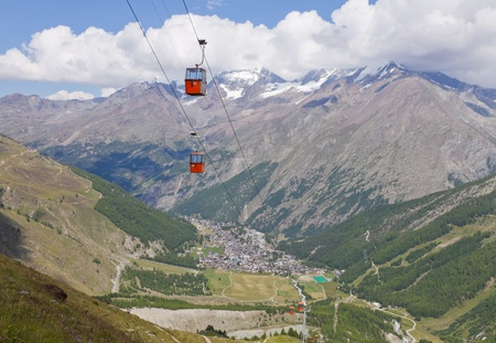saas fee: Alpine town of Saas Fee in Saas valley surrounded by high mountains, connected by cable car, Valais, Switzerland