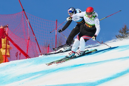GRINDELWALD � MARCH 10: Athletes fight for lead position at FIS Skicross Worldcup March 10, 2012 in Grindelwald, Switzerland. Racer Nick Zoricic died during the race, crashing into a safety fence. Stock Photo - 12641871