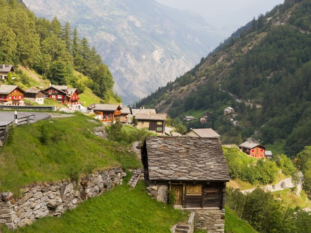 wooden houses: small swiss village settlement Saas Balen of wooden, slate roof houses in Saas valley canton Valais  Switzerland