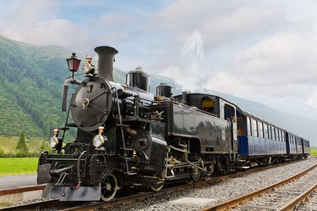railway history: vintage black steam powered railway train