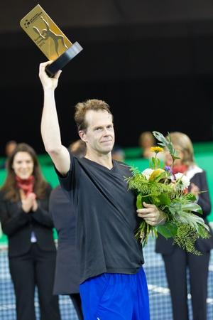 paribas: ZURICH, SWITZERLAND-MARCH 24: Stefan Edberg receives a trophy for 2. place in final of BNP Paribas Open Champions Tour aganinst Carlos Moya in Zurich, SUI on March 24, 2012.