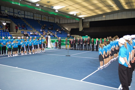 paribas: ZURICH, SWITZERLAND-MARCH 24: Officials, sponsors, linesmen and ball kids line up for award ceremony at BNP Paribas Open Champions Tour in Zurich, SUI on March 24, 2012.