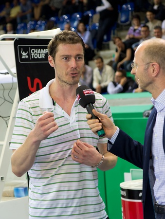 paribas: ZURICH, SWITZERLAND-MARCH 24: Marat Safin (l.) gives interviews after the 3rd place match against Mark Philippoussis which he lost at BNP Paribas Open Champions Tour in Zurich, SUI on March 24, 2012.