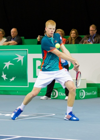 ZURICH, SWITZERLAND-MARCH 24: Kyle Edmund plays tennis in final of BNP Paribas Open Champions Tour against Mitchell Krueger in Zurich, SUI on March 24, 2012.  He won the title in category talents. Stock Photo - 12818424