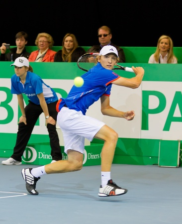 ZURICH, SWITZERLAND-MARCH 24: Mitchell Krueger plays tennis in final of BNP Paribas Open Champions Tour against Kyle Edmund in Zurich, SUI on March 24, 2012.  He took 2. Place in category talents.