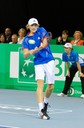 kyle: ZURICH, SWITZERLAND-MARCH 24: Mitchell Krueger plays tennis in final of BNP Paribas Open Champions Tour against Kyle Edmund in Zurich, SUI on March 24, 2012.  He took 2. Place in category talents.
