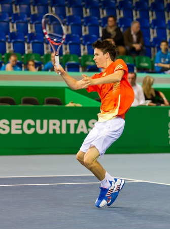 ZURICH, SWITZERLAND-MARCH 24: Julien Cagnina plays tennis for 3rd place of BNP Paribas Open Champions Tour in category talents against Alexander Ritschard in Zurich, SUI on March 24, 2012.  He won. Stock Photo - 12818401