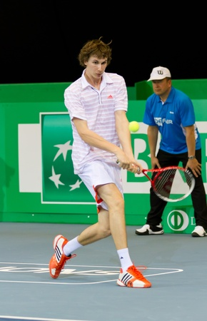 paribas: ZURICH, SWITZERLAND-MARCH 24: Alexander Ritschard plays tennis for 3rd place of BNP Paribas Open Champions Tour in category talents against Julien Cagnina in Zurich, SUI on March 24, 2012.  He lost. Editorial