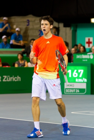 paribas: ZURICH, SWITZERLAND-MARCH 24: Julien Cagnina plays tennis for 3rd place of BNP Paribas Open Champions Tour in category talents against Alexander Ritschard in Zurich, SUI on March 24, 2012.  He won.