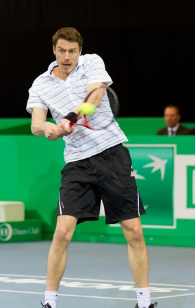 paribas: ZURICH, SWITZERLAND-MARCH 24: Marat Safin plays tennis for 3rd place at BNP Paribas Open Champions Tour against Mark Philippoussis in Zurich, SUI on March 24, 2012.  He lost the match.