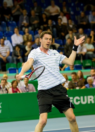 ZURICH, SWITZERLAND-MARCH 24: Marat Safin plays tennis for 3rd place at BNP Paribas Open Champions Tour against Mark Philippoussis in Zurich, SUI on March 24, 2012.  He lost the match. Stock Photo - 12818406