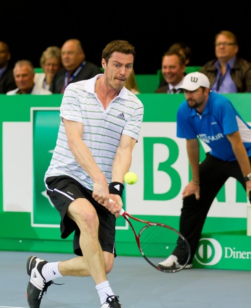 ZURICH, SWITZERLAND-MARCH 24: Marat Safin plays tennis for 3rd place at BNP Paribas Open Champions Tour against Mark Philippoussis in Zurich, SUI on March 24, 2012.  He lost the match.