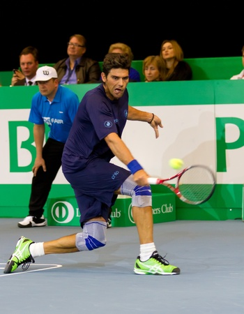 paribas: ZURICH, SWITZERLAND-MARCH 24: Mark Philippoussis plays tennis for 3rd place at BNP Paribas Open Champions Tour against Marat Safin in Zurich, SUI on March 24, 2012.  He won mainly to his strong serve.
