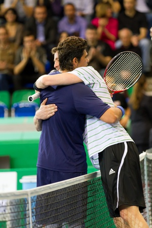 paribas: ZURICH, SWITZERLAND-MARCH 24: Mark Philippoussis (l.) and Marat Safin hug after the 3rd place match at BNP Paribas Open Champions Tour in Zurich, SUI on March 24, 2012.  Philippoussis won.