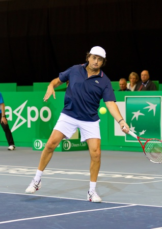 ZURICH, SWITZERLAND-MARCH 24: Henri Leconte plays tennis in double final of BNP Paribas Open Champions Tour aganinst Tim Henman in Zurich, SUI on March 24, 2012.  Duo Henman, Edwards won the title.