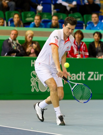 ZURICH, SWITZERLAND-MARCH 24: Tim Henman plays tennis in double final of BNP Paribas Open Champions Tour aganinst Henri Leconte in Zurich, SUI on March 24, 2012.  Duo Henman, Edwards won the title. Stock Photo - 12818450