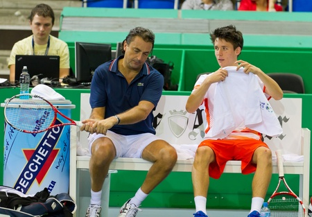 paribas: ZURICH, SWITZERLAND-MARCH 24: Henri Leconte (l.) gives advice to Julien Cagnina in double final of BNP Paribas Open Champions Tour in Zurich, SUI on March 24, 2012.  Duo Henman, Edwards won the title.