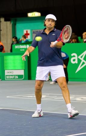 paribas: ZURICH, SWITZERLAND-MARCH 24: Henri Leconte plays tennis in double final of BNP Paribas Open Champions Tour aganinst Tim Henman in Zurich, SUI on March 24, 2012.  Duo Henman, Edwards won the title.
