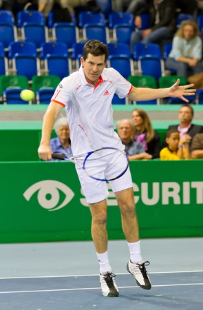 ZURICH, SWITZERLAND-MARCH 24: Tim Henman plays tennis in double final of BNP Paribas Open Champions Tour aganinst Henri Leconte in Zurich, SUI on March 24, 2012.  Duo Henman, Edwards won the title. Stock Photo - 12818458
