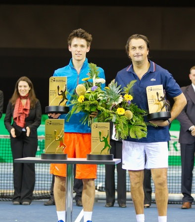 paribas: ZURICH, SWITZERLAND-MARCH 24: 2nd place Award for double competition pairing champs and talents for Henri Leconte (r.), J. Cagnina at BNP Paribas Open Champions Tour in Zurich, SUI on March 24, 2012. Editorial